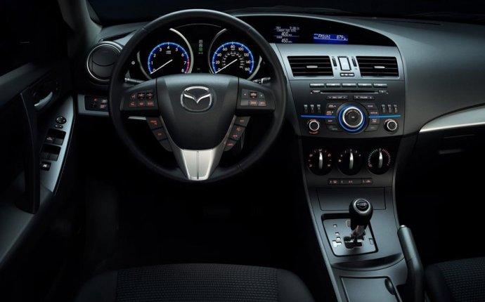 Фото салона автомобилей Mazda 3 (2011-2013). Интерьер Mazda 3